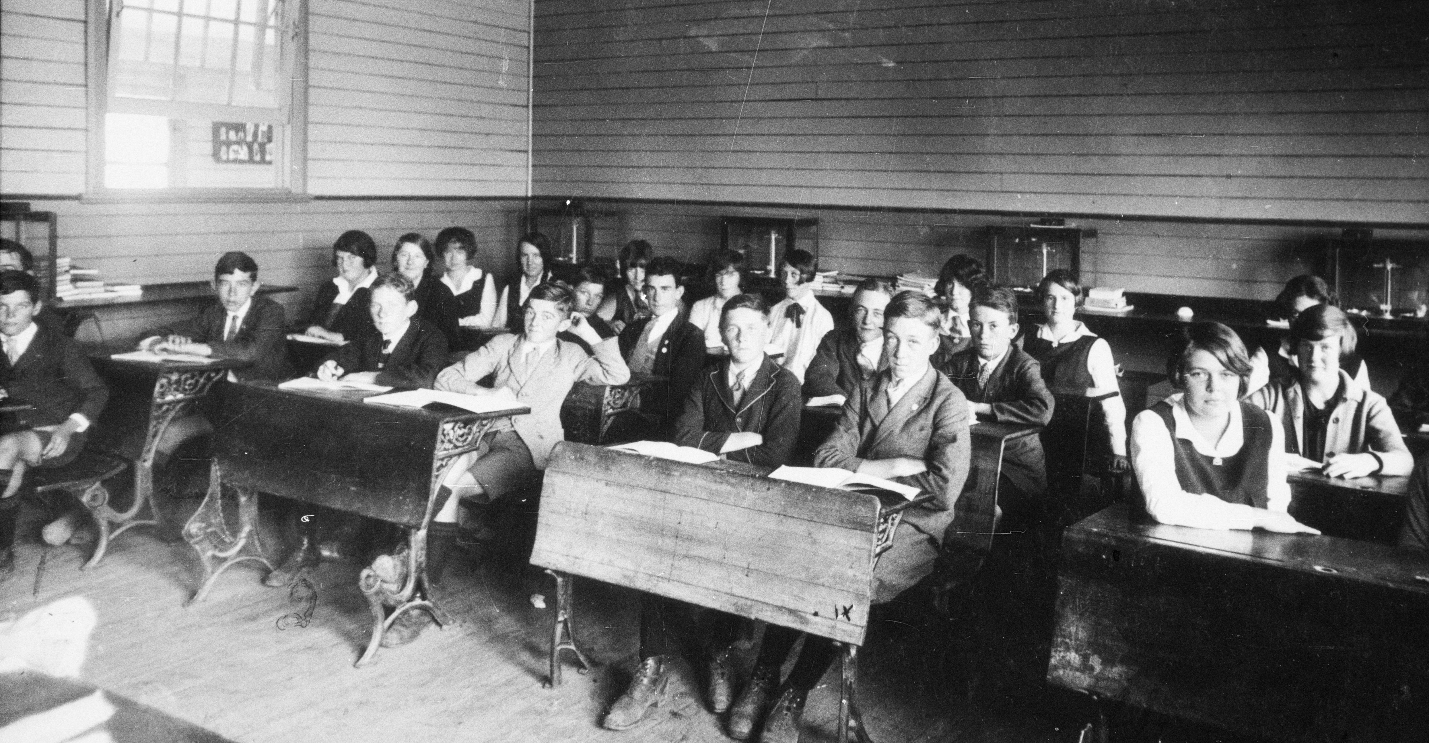 Adolescents coralled in classrooms, Deniliquen Intermediate High School, c 1935. State Library of New South Wales.