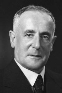 Photograph of Frank Milner, c. 1940. S. P. Andrew Ltd. Portrait negatives. 1/4-020167-F. Alexander Turnbull Library, Wellington, New Zealand.