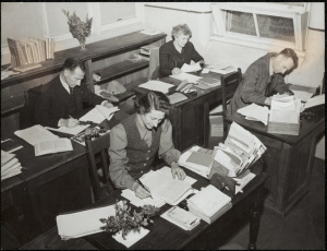 "Blackfriars teachers busy at work. From the Commonwealth Film Unit production ""School in the Mailbox"", directed by Stanley Hawes. Digital ID: 15051_a047_003382.jpg; c. 01/01/1946 © State of New South Wales through the State Records Authority of NSW"