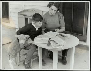 Close supervision by a mother of a young Blackfriars pupil with his pet. 15051_a047_003373 c. 01/01/1946 © State of New South Wales through the State Records Authority of NSW