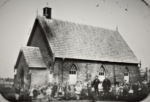 An elementary denominational school for children from families affiliated with the Church of England. Dunolly near Bendigo, Victoria, c. 1861. State Library of Victoria, b36129