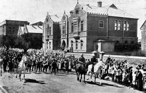 The AIF (Australian Imperial Force) marches past the school in 1916. ANZAC day was established, to be marked in all schools, a year or two later. School Magazine, 8:1, 1916.