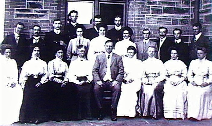 "The foundation teaching staff. William Adey, front row, centre. Madeline Rees George (""Headmistress"") to his left. 1908. State Library SA, B 29874"