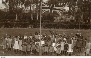 Saluting the flag of the colonisers (not all did in this image). Point McLeay, South Australia, 1912